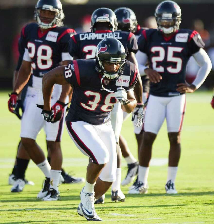Safety Danieal Manning (38) is one of the reasons the Texans expect improved play in the secondary. Manning and cornerback Johnathan Joseph were free-agent signees after playing last season with the Bears and Bengals, respectively. Photo: Brett Coomer, Staff / © 2010 Houston Chronicle
