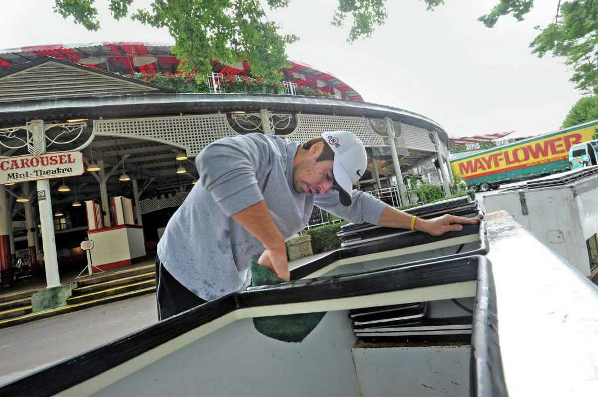 Alex Gotsch of Saratoga cleans out a Ben & Jerry's ice cream cooler at Saratoga Race Course on Sept. 6, 2011 in Saratoga Springs, N.Y. Yesterday was the last day of the meet. (Lori Van Buren / Times Union)
