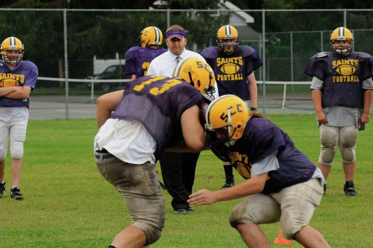 Spa Catholic High School head coach Steve Rossi runs his team through drills in Saratoga Springs, NY Tuesday Sept.6, 2011. ( Michael P. Farrell/Times Union)