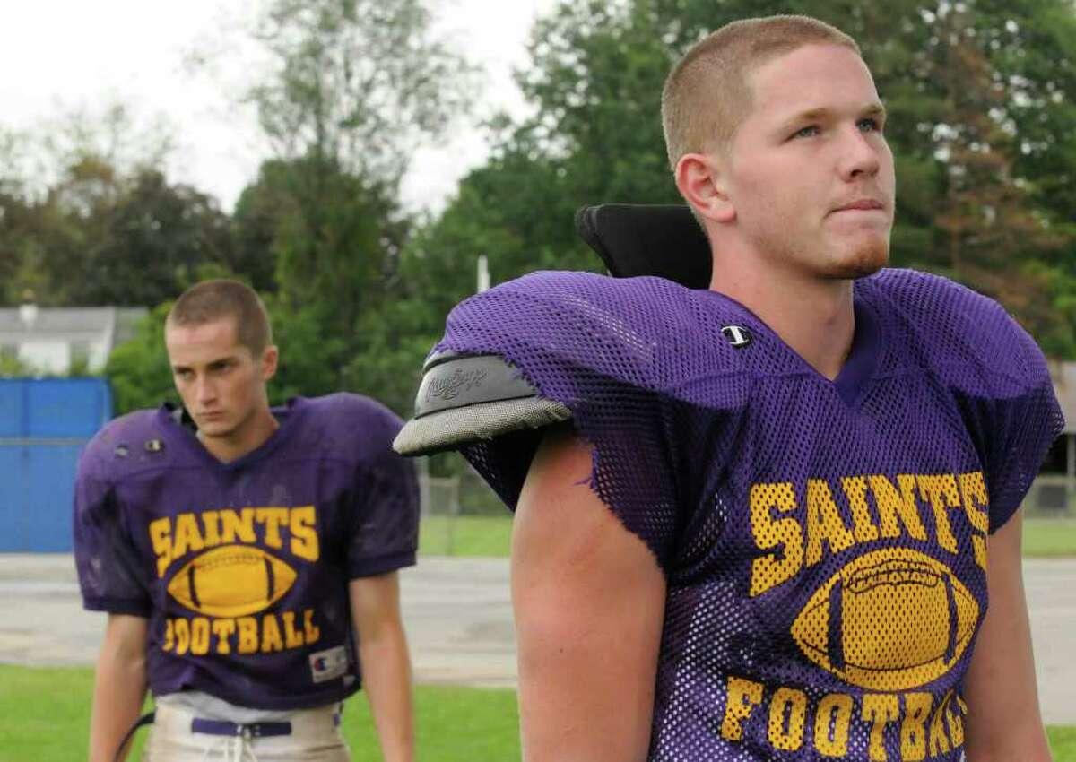Spa Catholic High School teammates Andrew Hadeka,left, and Matt Boyark during a break in practice in Saratoga Springs, NY Tuesday Sept.6, 2011. ( Michael P. Farrell/Times Union)