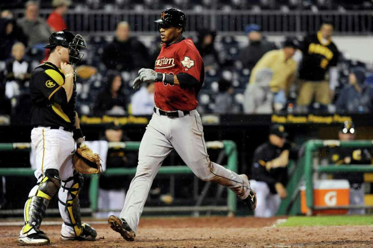 Houston Astros' Jimmy Paredes (38) scores on a base hit from Humberto Quintero, not pictured, during the ninth inning of a baseball game against the Pittsburgh Pirates Tuesday, Sept. 6, 2011 in Pittsburgh. Houston won 4-1.