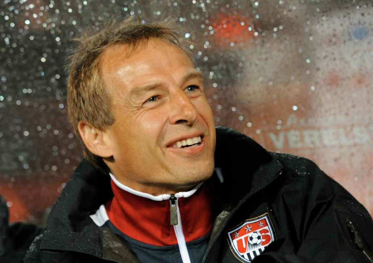 US head Coach Jurgen Klinsmann smiles during their Euro 2012 friendly football match Belgium against US at the stadium King Baudouin in Brussels on September 6, 2011. AFP PHOTO/ JOHN THYS (Photo credit should read JOHN THYS/AFP/Getty Images)