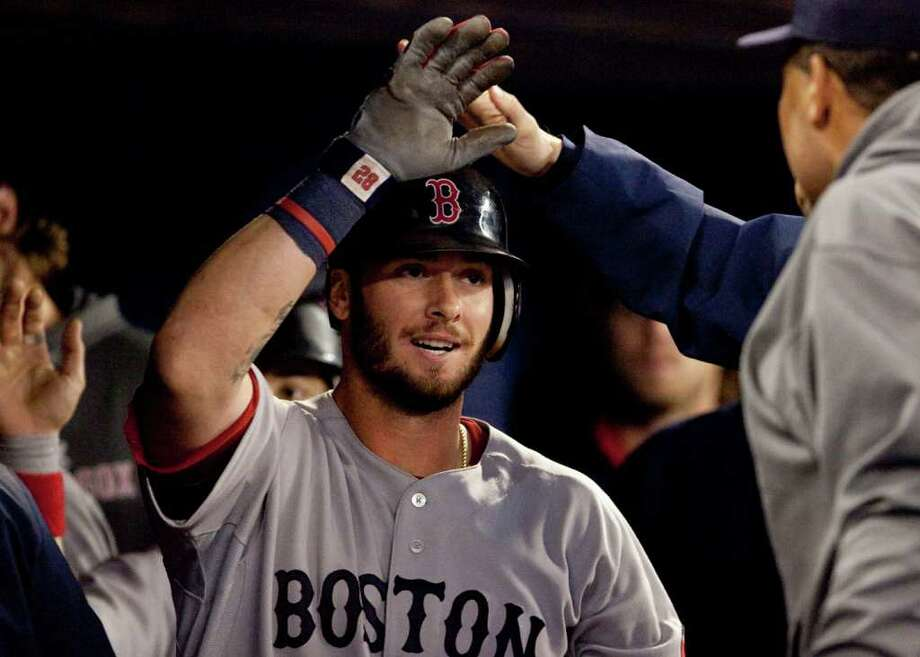 Boston Red Sox's Jarrod Saltalamacchia celebrates in the dugout following a two-run home run in the third inning of a baseball game against the Toronto Blue Jays in Toronto Tuesday, Sept. 6, 2011. (AP Photo/The Canadian Press, Darren Calabrese) Photo: Darren Calabrese