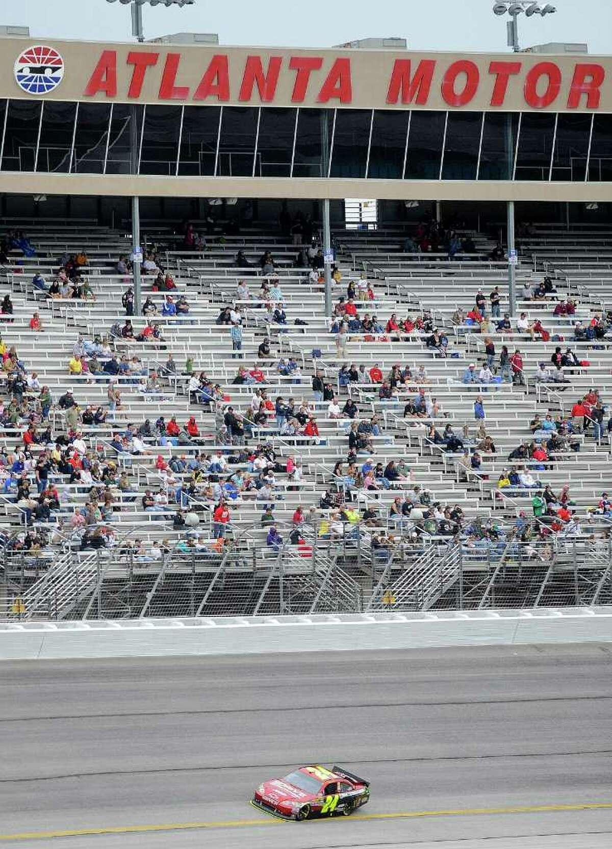 Sprint Cup Series driver Jeff Gordon races during the NASCAR Sprint Cup AdvoCare 500 auto race, Tuesday, Sept. 6, 2011, at the Atlanta Motor Speedway, near Hampton, Ga. Gordon won the race. (AP Photo/Mike Stewart)