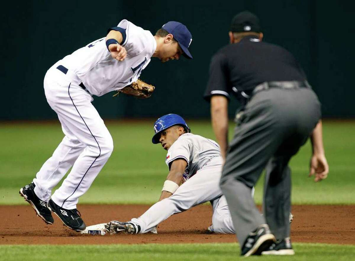 Tampa Bay Rays second baseman Ben Zobrist, left, leaves his feet after tagging out Texas Rangers' Endy Chavez attempting to steal second base during the second inning of a baseball game Tuesday, Sept. 6, 2011, in St. Petersburg, Fla.