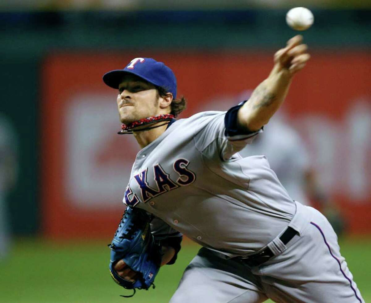 Texas Rangers starting pitcher C.J. Wilson delivers to the Tampa Bay Rays during the second inning of a baseball game Tuesday, Sept. 6, 2011, in St. Petersburg, Fla.