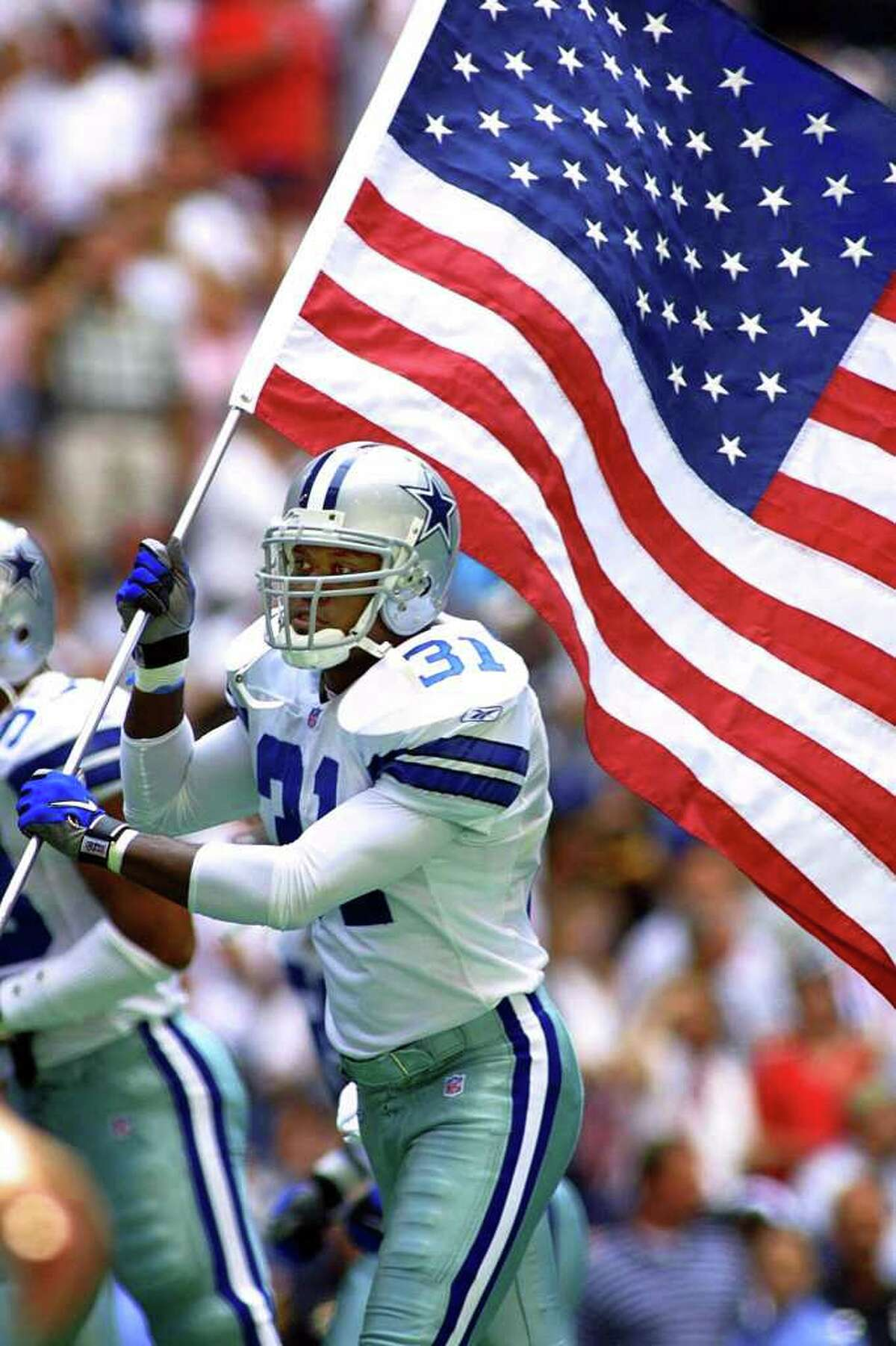 Cowboys safety George Teague takes the field Sept. 23, 2001, after the NFL postponed play for a week.