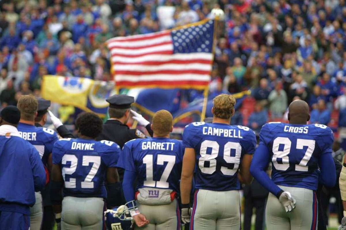 Cowboys coach Jason Garrett was a backup quarterback for the New York Giants during the 2001 season. He recalls flying into Newark, N.J., on Sept. 11, hearing the endless wail of sirens from his Manhattan apartment, and witnessing the city's response.