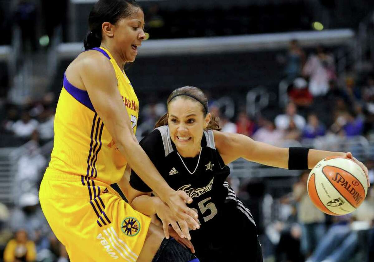 San Antonio Silver Stars guard Becky Hammon, right, drives on Los Angeles Sparks forward Candace Parker, left, as she moves to the basket in the first half of a WNBA basketball game, Tuesday, Sept. 6, 2011, in Los Angeles.