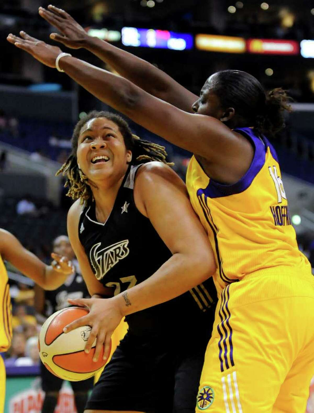 San Antonio Silver Stars forward Danielle Adams, left attempts to get around Los Angeles Sparks forward Ebony Hoffman as she drives to the basket in the first half of a WNBA basketball game, Tuesday, Sept. 6, 2011, in Los Angeles.