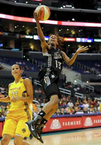 San Antonio Silver Stars guard Danielle Robinson (13) gets by Los Angeles Sparks guard Ticha Penicheiro (21), of Portugal, as she scores a basket on a fast break in the first half of a WNBA basketball game, Tuesday, Sept. 6, 2011, in Los Angeles. Photo: Gus Ruelas/Associated Press