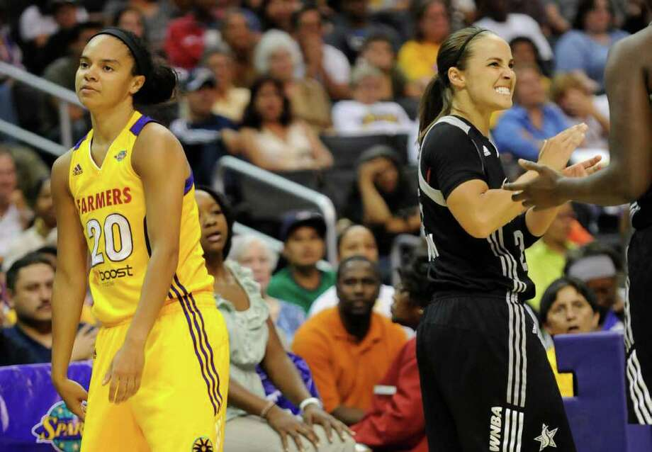 Los Angeles Sparks guard Kristi Toliver (20) and San Antonio Silver Stars guard Becky Hammon (25) react to a possession call in the second half of a WNBA basketball game, Tuesday, Sept. 6, 2011, in Los Angeles. The Silver Stars won 82-65. Photo: Gus Ruelas/Associated Press