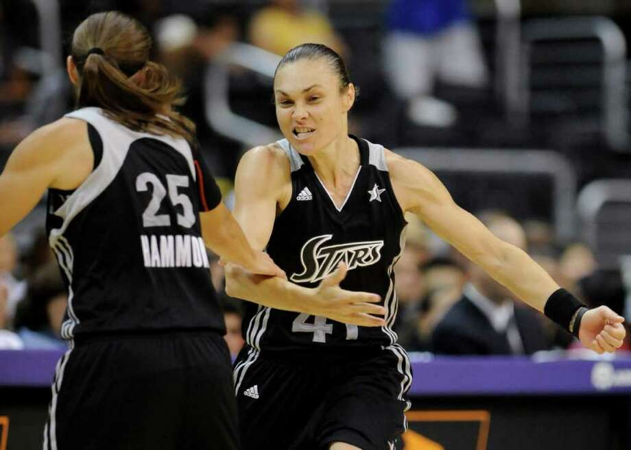 San Antonio Silver Stars guard Tully Bevilaqua (41), of Australia, celebrates her three point basket with teammate guard Becky Hammon (25) in the second half of a WNBA basketball game against the Los Angeles Sparks, Tuesday, Sept. 6, 2011, in Los Angeles. The Silver Stars won 82-65. Photo: Gus Ruelas/Associated Press