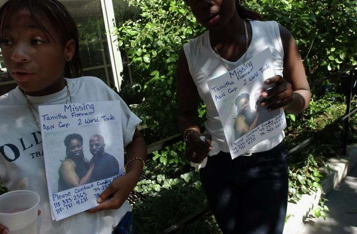 Melinda White, left, and Franchon Dixon display signs in the hope of finding their missing aunt, Tamitha Freeman of Brooklyn, who worked on the 98th floor of the World Trade Center, on Wednesday, Sept. 12, 2001. (Steve Jacobs / Times Union)
