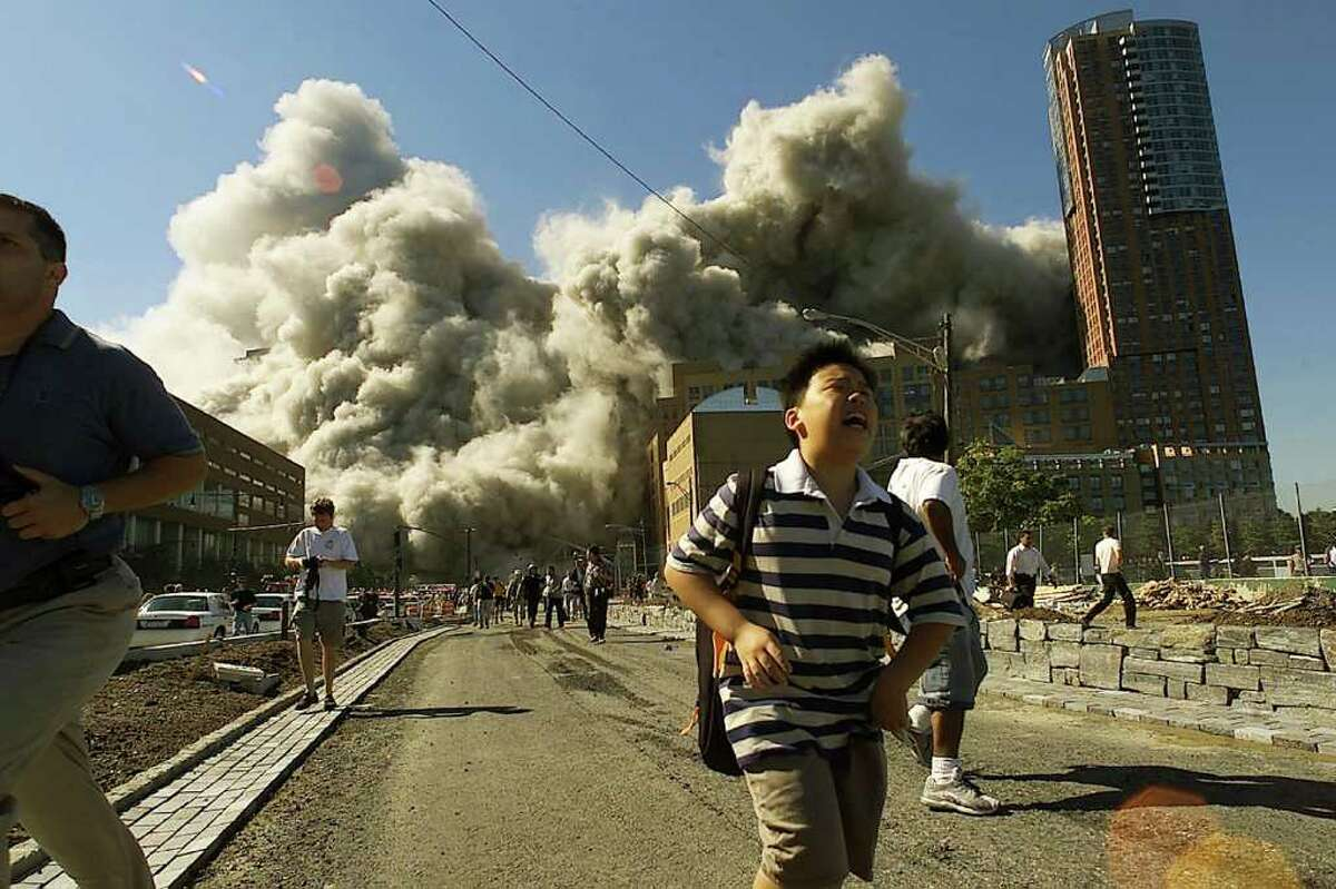 NEW YORK - SEPTEMBER 11, 2001: People run away as the North Tower of World Trade Center collapses after a hijacked airliner hit the building September 11, 2001 in New York City. This September 11 marks ten years since members of Al Qaeda hijacked four planes, attacking the World Trade Center and the Pentagon and crashing one in Shanksville, Pennsylvania, killing nearly 3,000 people in all. The effects continue to resonate across the global political landscape, as the United States concluded a nearly decade-long search for Al Qaeda leader Osama bin Laden, killing him in May 2011, and struggles to wind down two wars in Afghanistan and Iraq. (Photo by Jose Jimenez/Primera Hora/Getty Images)