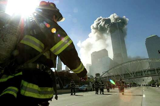 NEW YORK - SEPTEMBER 11, 2001: Firefighters walk towards one of the towers at the World Trade Center before it collapsed after a plane hit the building September 11, 2001 in New York City. This September 11 marks ten years since members of Al Qaeda hijacked four planes, attacking the World Trade Center and the Pentagon and crashing one in Shanksville, Pennsylvania, killing nearly 3,000 people in all. The effects continue to resonate across the global political landscape, as the United States concluded a nearly decade-long search for Al Qaeda leader Osama bin Laden, killing him in May 2011, and struggles to wind down two wars in Afghanistan and Iraq.  (Photo by Jose Jimenez/Primera Hora/Getty Images) Photo: Jose Jimenez/Primera Hora