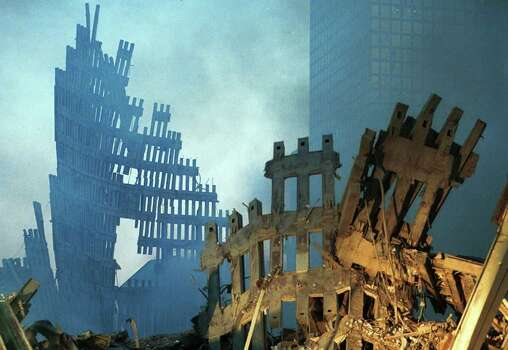NEW YORK - SEPTEMBER 13, 2001: Early morning light hits the smoke and wreckage of the World Trade Center, two days after the twin towers were destroyed after being hit by two hijacked passenger jets, September 13, 2001 in New York City. This September 11 marks ten years since members of Al Qaeda hijacked four planes, attacking the World Trade Center and the Pentagon and crashing one in Shanksville, Pennsylvania, killing nearly 3,000 people in all. The effects continue to resonate across the global political landscape, as the United States concluded a nearly decade-long search for Al Qaeda leader Osama bin Laden, killing him in May 2011, and struggles to wind down two wars in Afghanistan and Iraq.  (Photo by Chris Hondros/Getty Images) Photo: Chris Hondros