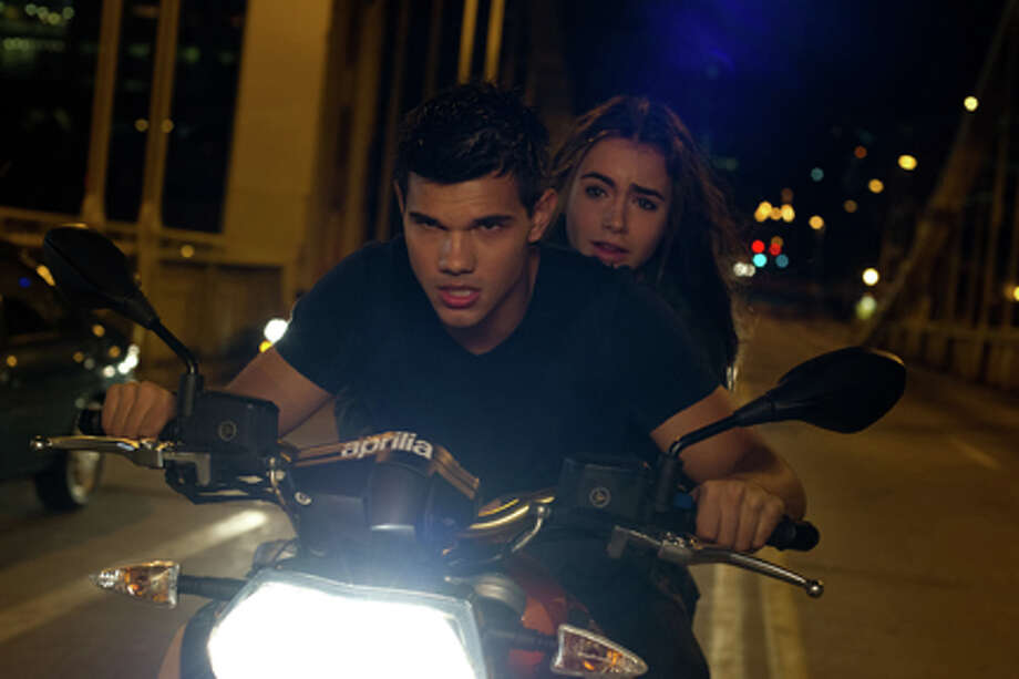 "Taylor Lautner as Nathan and Lily Collins as Karen in ""Abduction."" Photo: Photo Credit: Bruce Talamon"