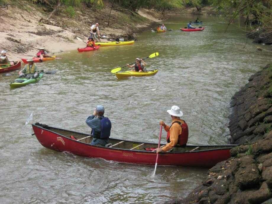 COURTESY PHOTO PADDLING FUN: Paddlers enjoy Buffalo Bayou. A bayou preservation work day is set for Sept. 17 at Terry Hershey Park. Photo: Courtesy