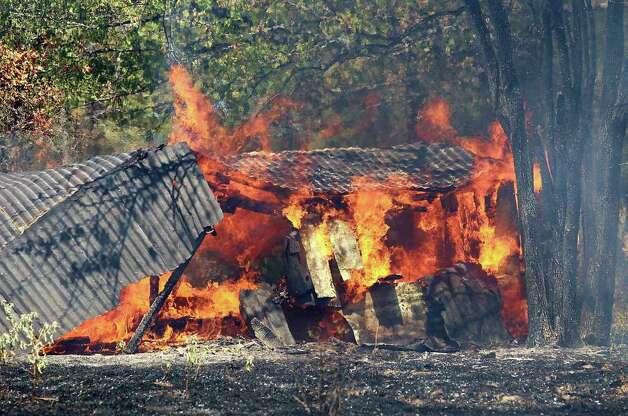 Fire spreads through a barn along Texas Spur 410 near Rugby, Texas on Tuesday, Sept. 6, 2011.  Law enforcement officers shortly before 1:30 p.m. Tuesday had in custody a suspect who possibly had a connection to fires in both counties. (AP Photo/The Paris News, Sam Craft)  MANDATORY CREDIT Photo: AP