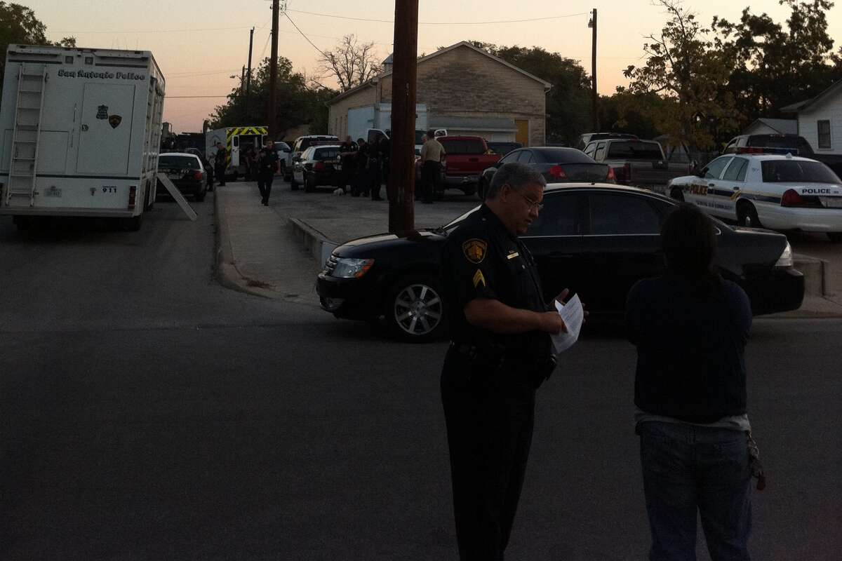 Police speak with relatives at the scene of a standoff Wednesday morning.