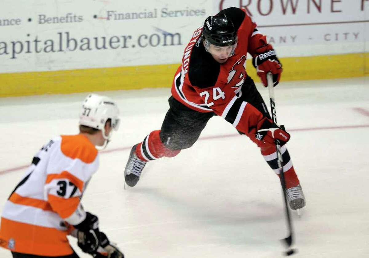 Alexander Vasyunov, with the Albany Devils, take a shot on goal past an Adirondack Phantoms player during their hockey game at the Times Union Center in Albany, NY on Sunday, 2/20/11. (Paul Buckowski / Times Union)