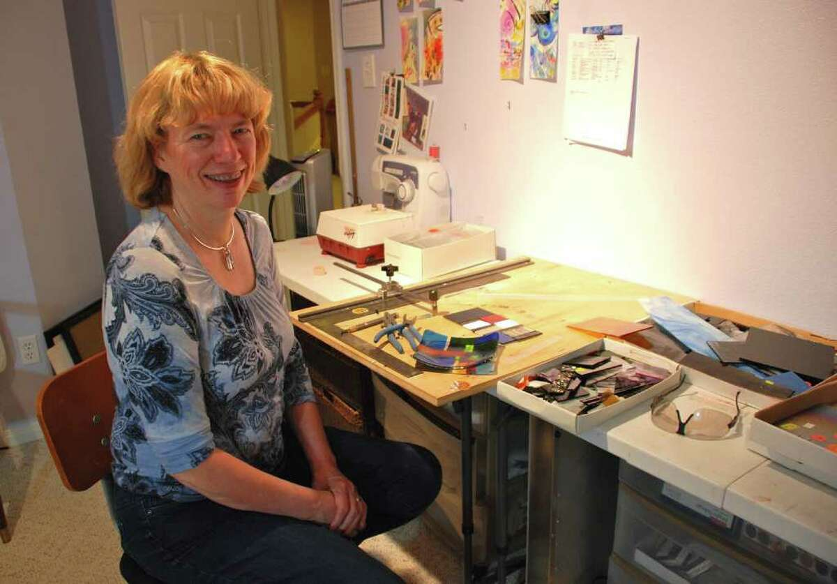 LINDSAY PEYTON: FOR THE CHRONICLE AT HOME: Laurie Stone Adams, art teacher at McCullough Junior High, makes time to work on her own creations.