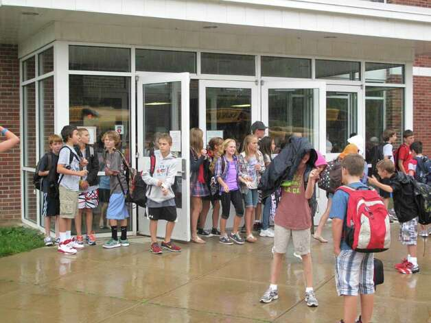 The fifth and sixth graders at saxe middle school storm out of the