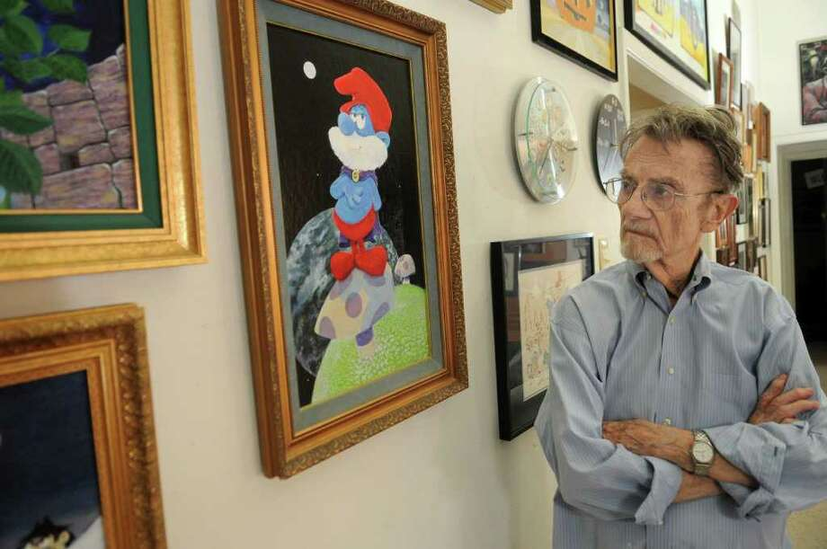 """JERRY BAKER PHOTOS: FOR THE CHRONICLE PAPPA SMURF: Gerard Baldwin of Kingwood, who was the supervising producer of """"The Smurfs"""" animated cartoon from the 1980s, looks at his painting of """"Papa Smurf"""" at his home.  Freelance photo by Jerry Baker Photo: Jerry Baker, Freelance"""