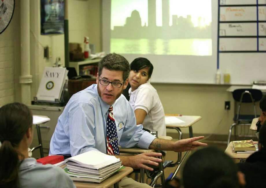 Teacher Chris Van Etten discusses the 9/11 tragedy with one of his seventh grade classes at Park City Prep charter school in Bridgeport on Wednesday, September 7, 2011. Photo: Brian A. Pounds / Connecticut Post
