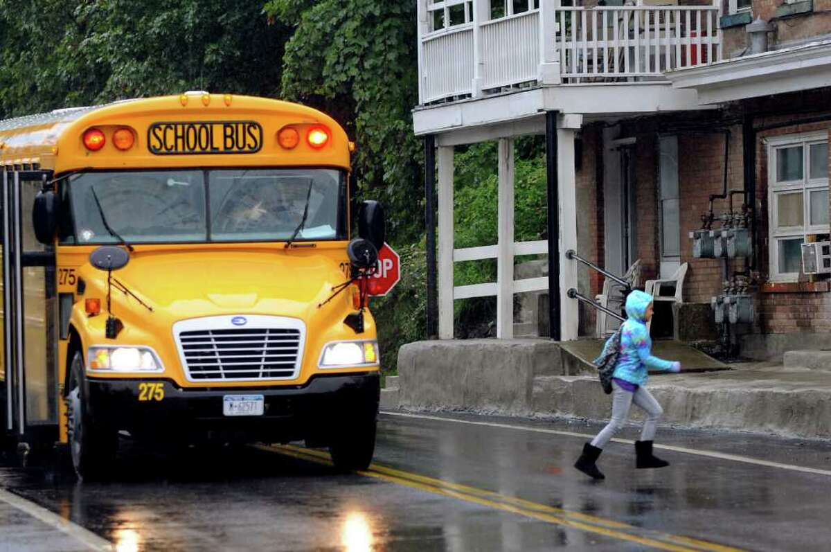 A child gets off the bus Wednesday after school closed early in Coeymans. (Cindy Schultz / Times Union)