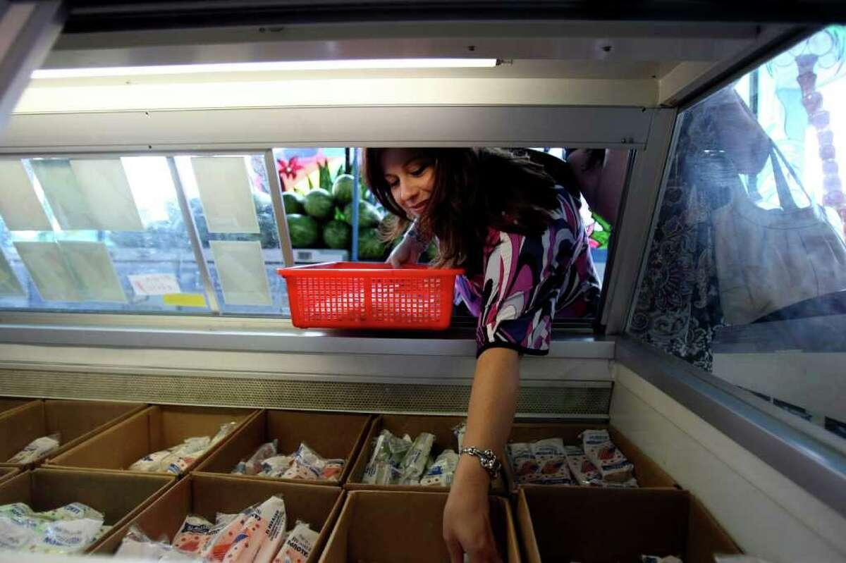 Felicia Tabares reaches into the cooler at El Paraiso for paletas on Thursday Sept. 1, 2011.