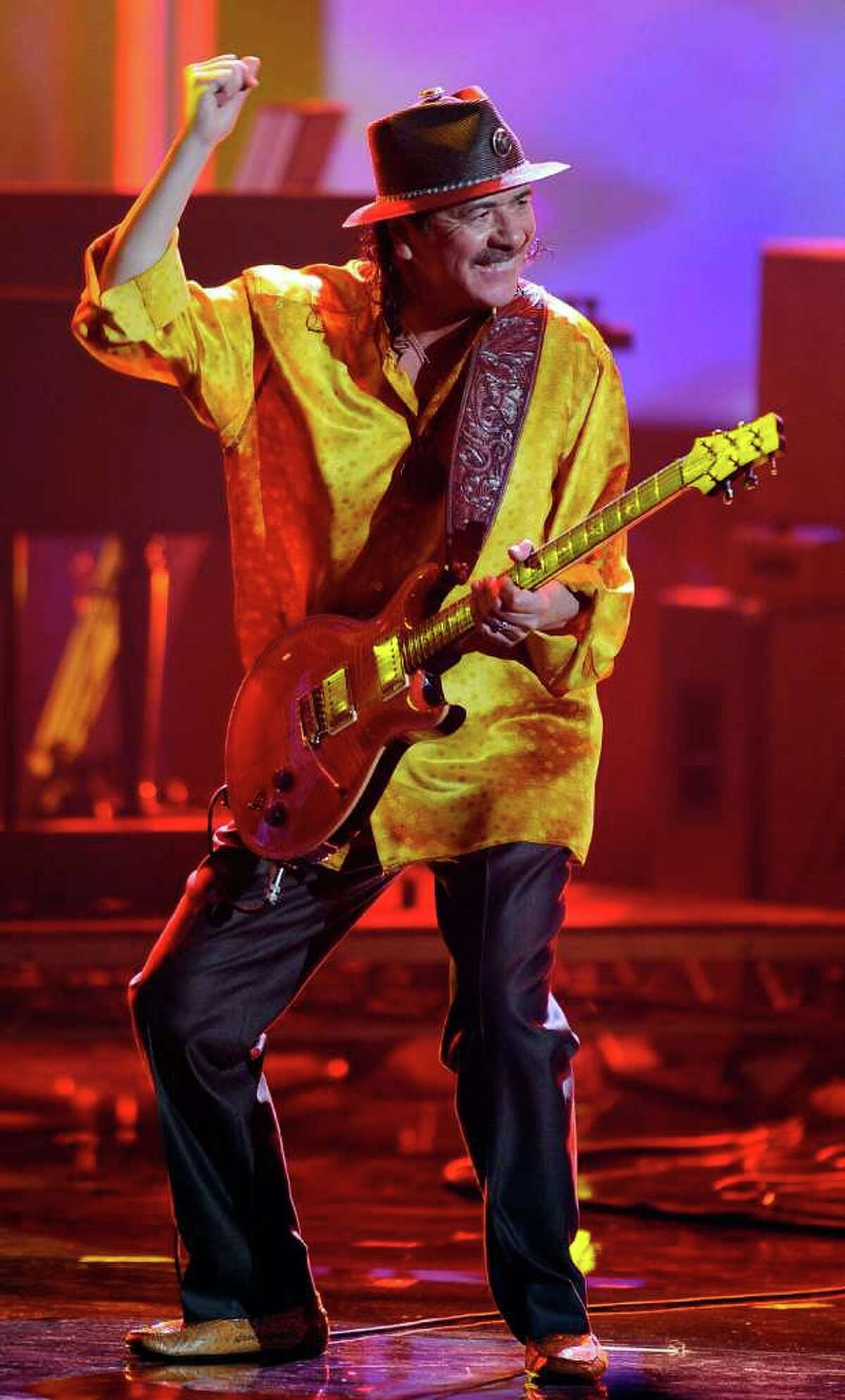 Musician Carlos Santana performs onstage during the 2010 American Music Awards held at Nokia Theatre L.A. Live on November 21, 2010 in Los Angeles, California.