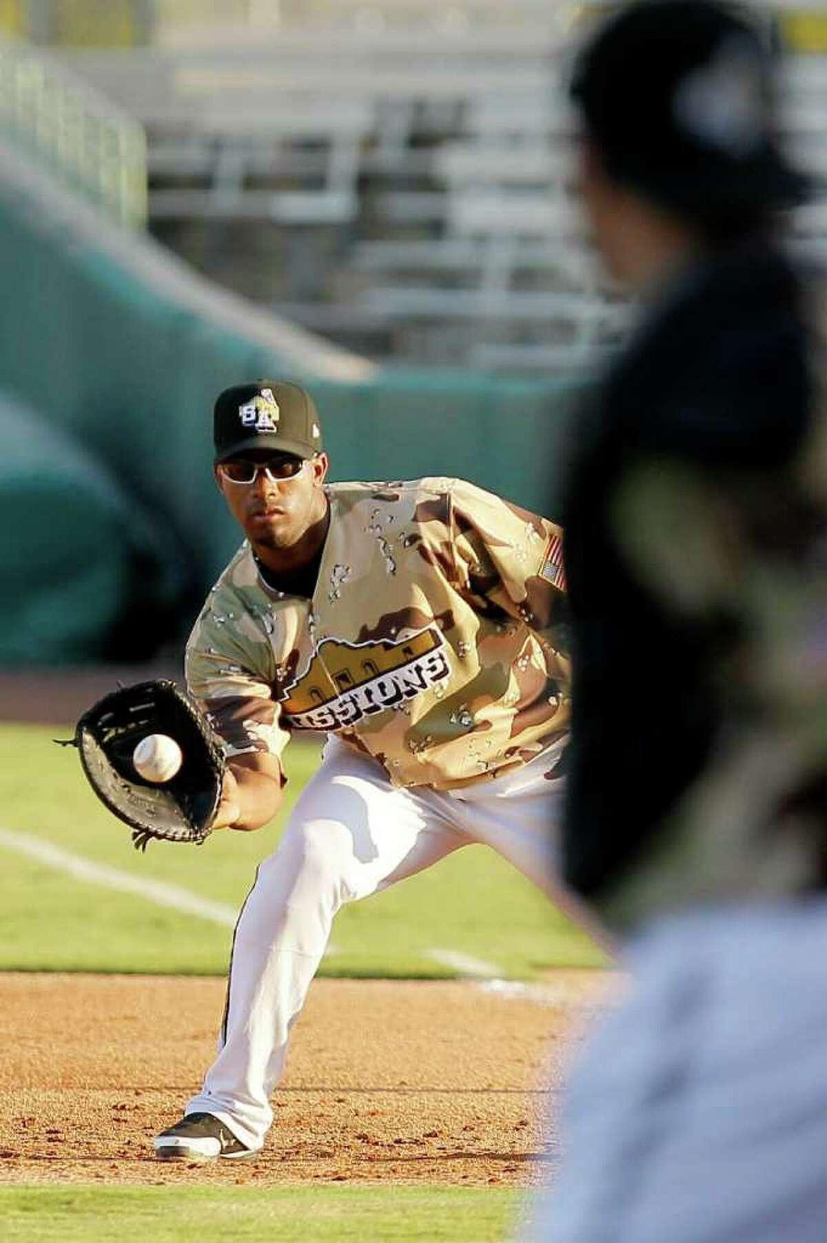 San Antonio Missions first baseman Carlos Sosa catches the ball during a Texas League baseball game against the Arkansas Travelers, Sunday, Aug. 21, 2011, in San Antonio.