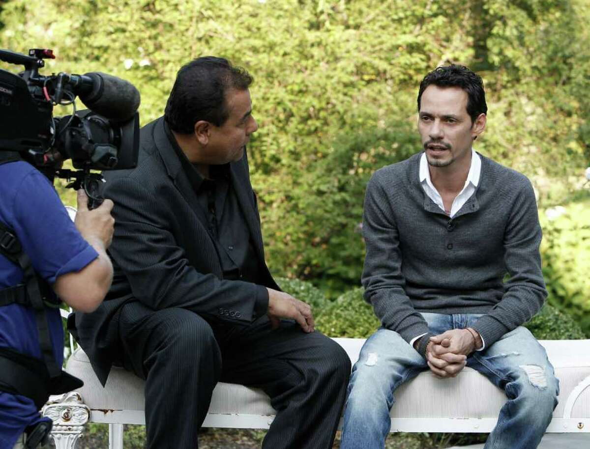 In this image released by ABC, ABC News correspondent John Quinones, left, speaks with singer and actor Marc Anthony in an interview, Friday, Aug. 26, 2011, in New York.