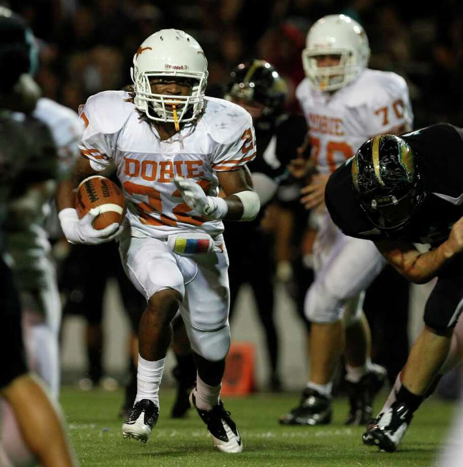 Pasadena Dobie (22) Andrew Robinson carries the ball during fourth quarter of game against Pasadena Memorial at Pasadena Veteran's Stadium, 2906 Dabney,  Thursday, Oct. 14, 2010, in Pasadena. ( Melissa Phillip / Houston Chronicle ) Photo: Melissa Phillip / Houston Chronicle
