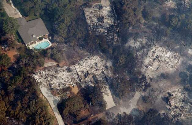 Homes destroyed by wildfire are seen Wednesday, Sept. 7, 2011, in Bastrop, Texas. The fire has destroyed more than 600 homes and blackened about 45 square miles in and around Bastrop. A search team on Wednesday will begin looking for more possible victims of the fire, which has killed two people and forced thousands to evacuate. Photo: AP