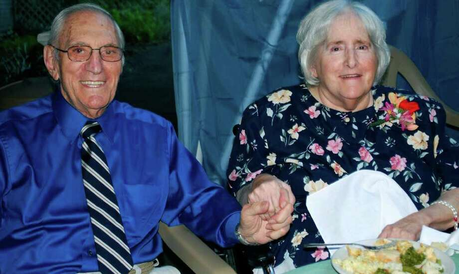 SPECTRUM/Al Ottanio and his wife, Barbara, a resident of Village Crest Center for Health and Rehabilitation in New Milford, hold hands during the facility's Aug. 26, 2011 senior prom. Photo: Deborah Rose