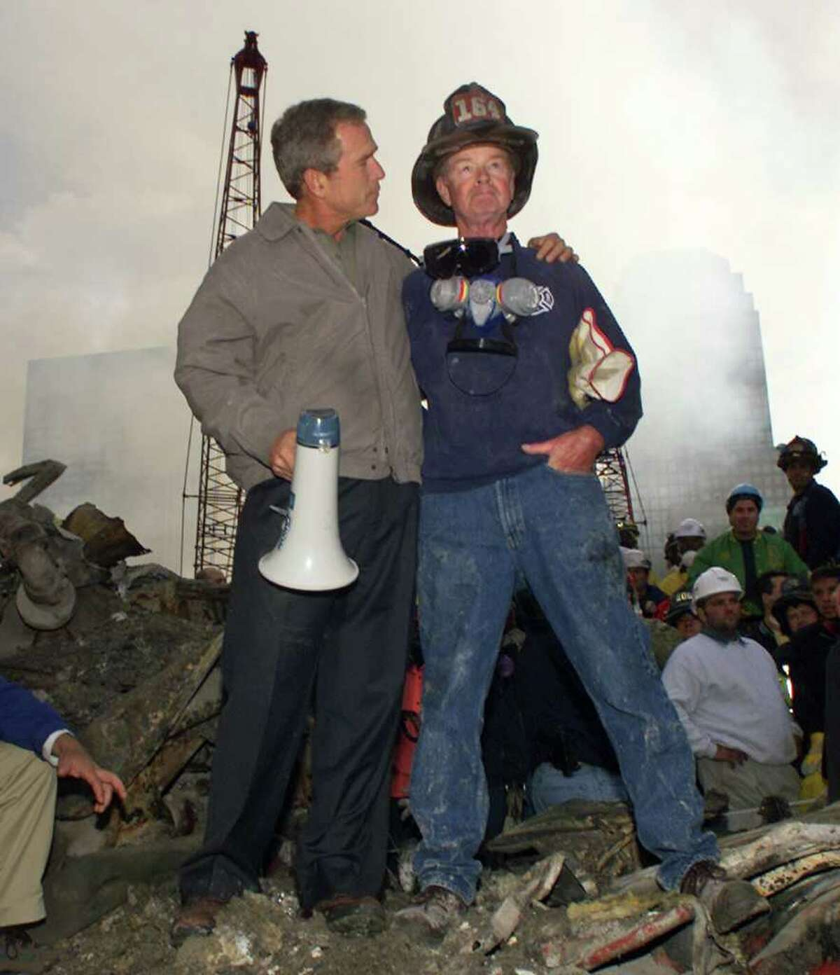 Bob Beckwith Retired firefighter Bob Beckwith found himself thrust into the spotlight after being captured in an iconic photo with President Bush. Though he was nearly 70 years old at the time of the attacks, Beckwith was spurred to action. Dressed in old FDNY gear, he managed to gain access to the WTC wreckage and help with rescue efforts.