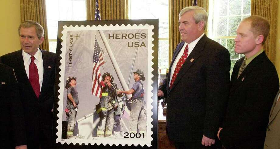 Though the three firefighters have refused all media requests for interviews, choosing to stay out of the spotlight, they have continued their careers with the FDNY for the past 10 years. The image has been immortalized on newspaper front pages, postage stamps, and magazine covers alike. Photographer Thomas E. Franklin, pictured at right, still works as a staff photographer at The Bergen Record in New Jersey. The flag in the photograph disappeared and remains missing to this day.  Photo: KENNETH LAMBERT, ASSOCIATED PRESS / AP2002