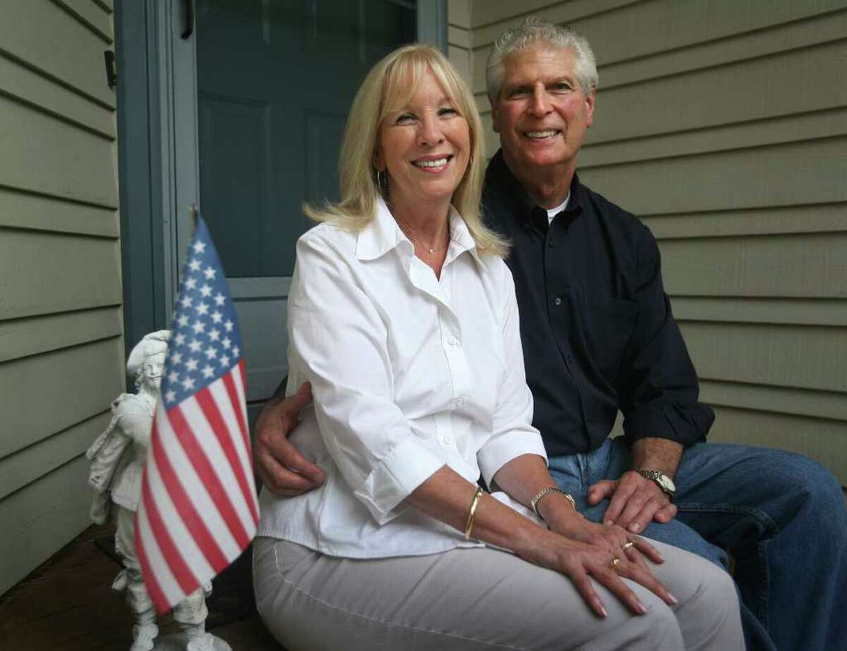 Rosemary and retired FDNY firefighter George Coronna in front of their Shelton home.