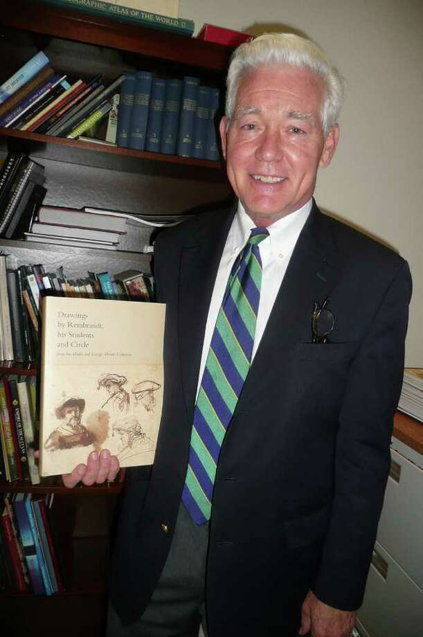 """Bruce Museum Executive Director Peter Sutton holds the hefty catalog for the upcoming show, """"Drawings by Rembrandt, his Students and Circle from the Maida and George Abrams Collection,"""" which he spent a year putting together. Photo: Anne W. Semmes"""