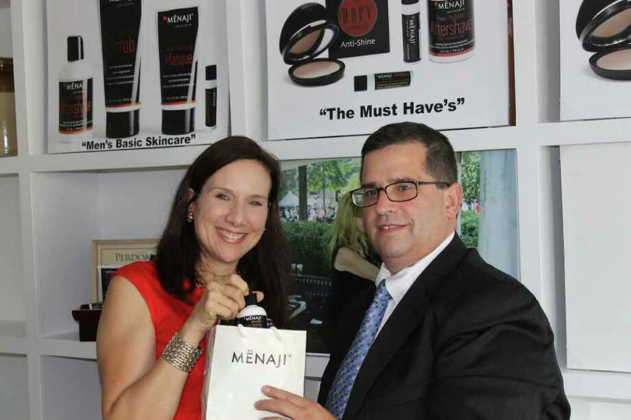 Jeffrey Glick, president of START U UP meets with Menaji's Pamela Viglielmo in the skincare company's show room to review upcoming holiday season promotions. Photo: Contributed Photo