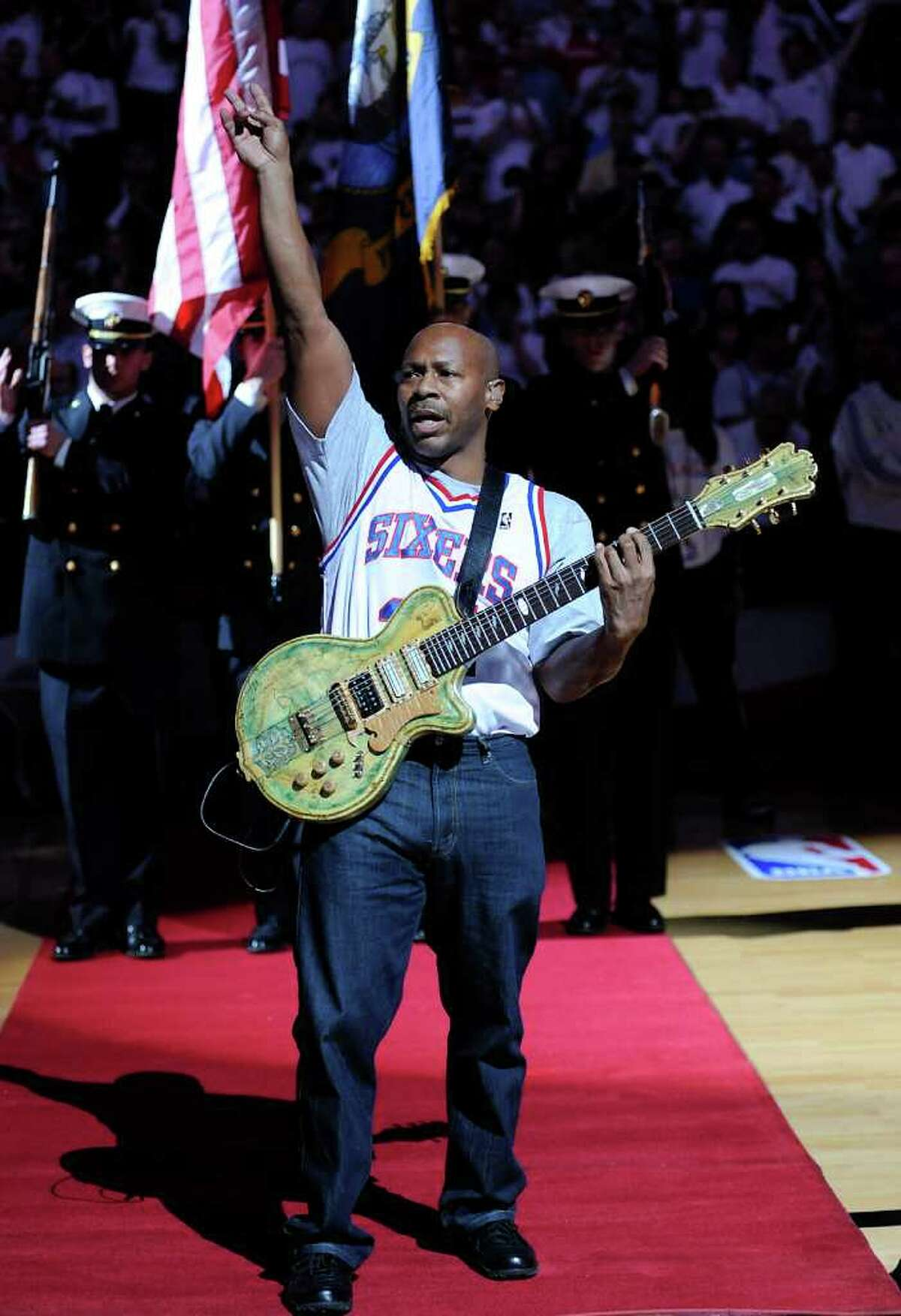 FILE - In this April 26, 2009 file photo, guitarist Kevin Eubanks preforms the national anthem before the start of Game 4 of an NBA basketball first-round playoff series between the Orlando Magic and the Philadelphia 76ers in Philadelphia. (AP Photo/Michael Perez, file)