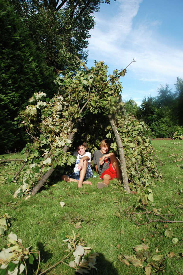 Drew Durkin and Jackson McNear of Pear Tree Point Road make good use of their time on what was supposed to be the first day of public school in Darien by creating a teepee from fallen branches after Hurricane Irene: solving problems and being creative. Photo: Contributed Photo