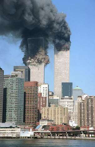 "In this Sept. 11, 2001 file photo, the south tower begins to collapse as smoke billows from both towers of the World Trade Center, in New York. Long-time Greenwich resident Karen Fassuliotis was there, in downtown Manhattan, as the terrible events of that day unfolded. ""As I emerged to street level I was greeted with dark smoke . . . I looked up and it was then that I saw the first World Trade tower ablaze,"" she writes. Photo: AP Photo/Jim Collins, ST / Connecticut Post Contributed; AP Photo/Jim Collins, File"