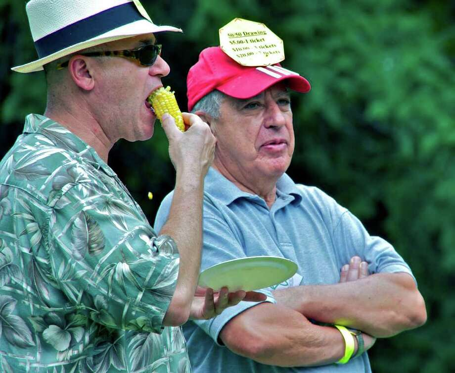 SPECTRUM/The culinary school family picnic featured a 50/50 raffle, coordinated byticket masters Jeff Kilberg, left, enjoying the corn on the cob, and Herb Morse. Mr. Morse serves on the school's board of directoes, as does Mr. Kilberg's wife, Susie. Aug. 6, 2011 Photo: Trish Haldin