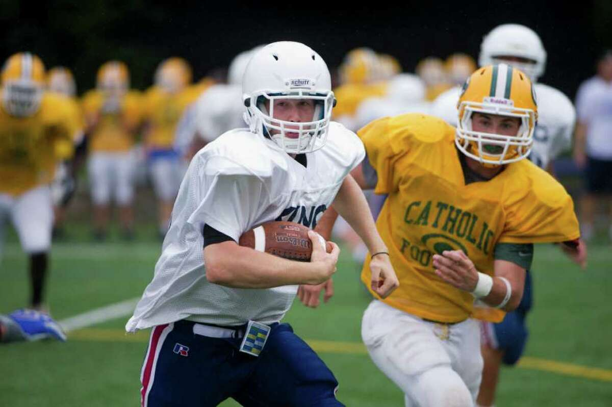 King Quarterback Kevin Peabody in action as King hosts Trinity Catholic in a football scrimmage in Stamford, Conn., September 7, 2011.