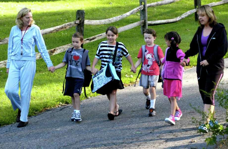 SPECTRUM/Leading a couple of their moms down to the kids' bus stop in Washiington on the first day of school for Region 12 schools are, from left to right, third-grader Trip Caco, third-grader Jewelliana Austin, second-grader Connor Ross and first-grader Haleigh Laboy. Being escorted are Laura Ross and Frannie Caco. Aug. 31, 2011 Photo: Norm Cummings