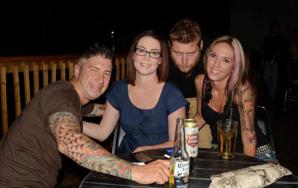 """Friends Chris Flores (from left), Whitney Dietz, Lexie Latnam and Bill McQueary drink at Dixie's Bar and Patio. """"It's a cool place,"""" Flores said. ROBIN JOHNSON / SPECIAL TO THE EXPRESS-NEWS"""
